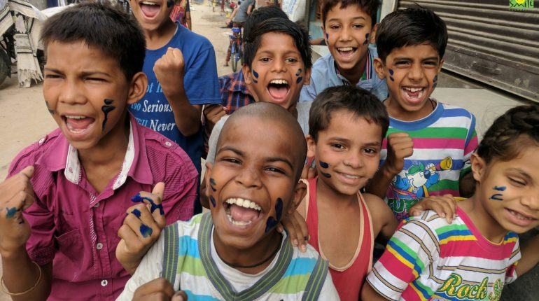 children looking at the camera and laughing