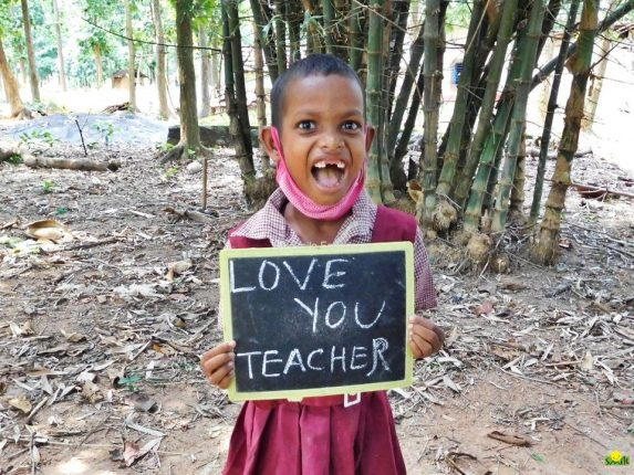 A child shows her appreciation for her teacher