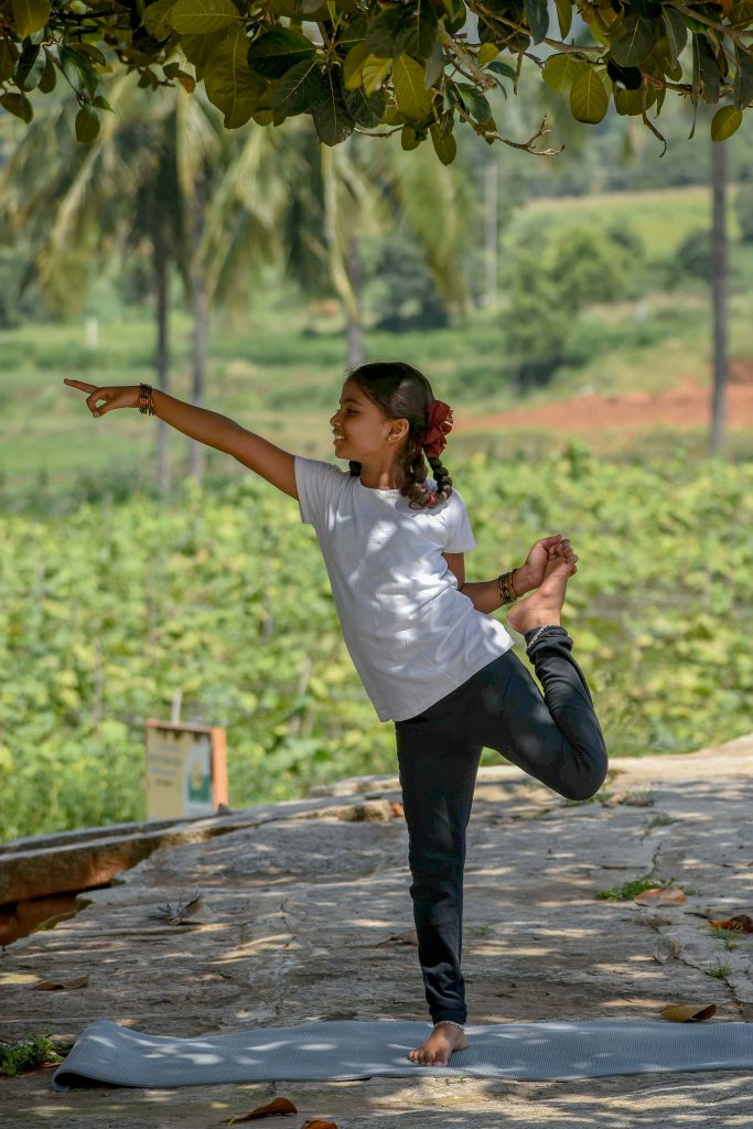 A child learning yoga at home during the lockdown