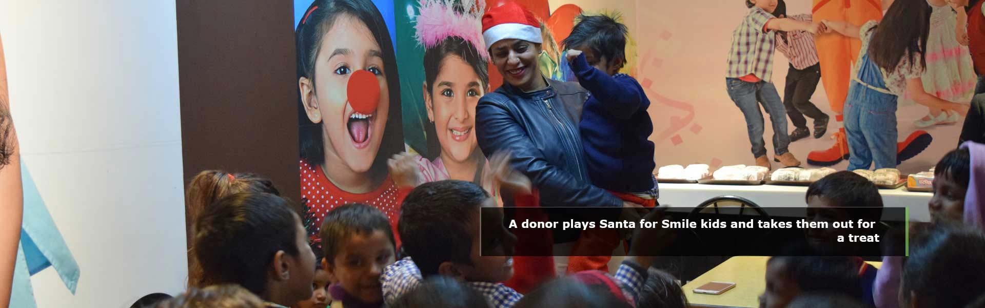 Smile Foundation - A donor plays Santa for Smile kids and takes them out for a treat
